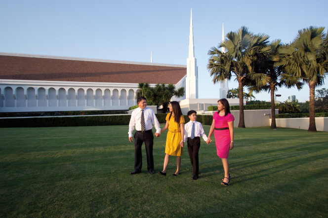 LDS family walking outside the temple