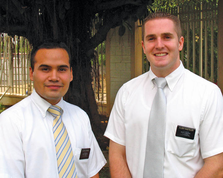 A photo of two Mormon elder missionaries.