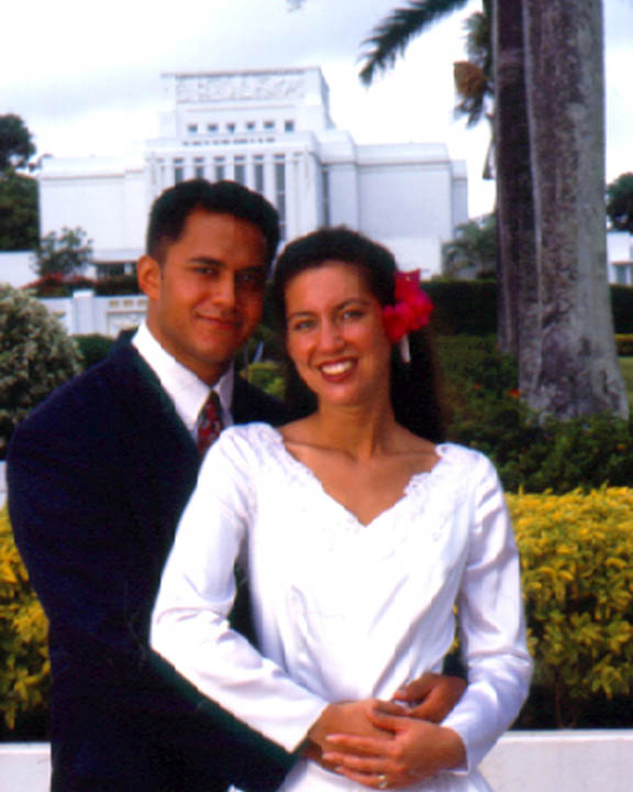 A photo of a Hawaiian couple standing in front of the Laie, Hawaii Mormon Temple after being married and sealed.