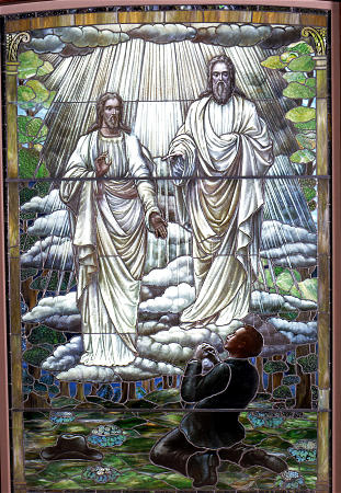 A stained glass artwork depicting Joseph Smith's first vision of God the Father and His Son, Jesus Christ.
