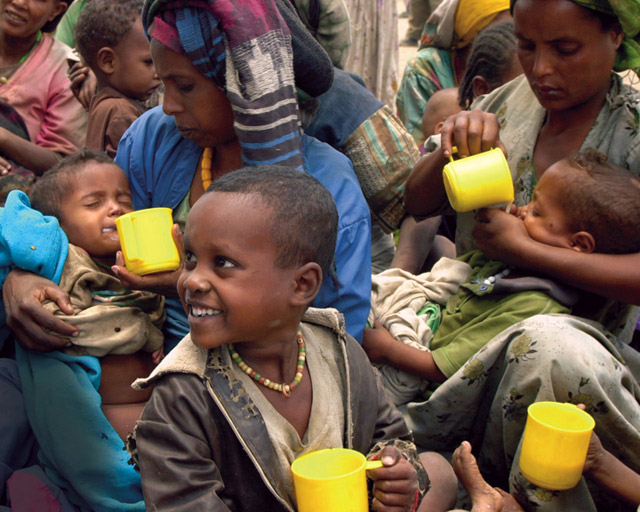 A photo of malnourished people receiving aid.