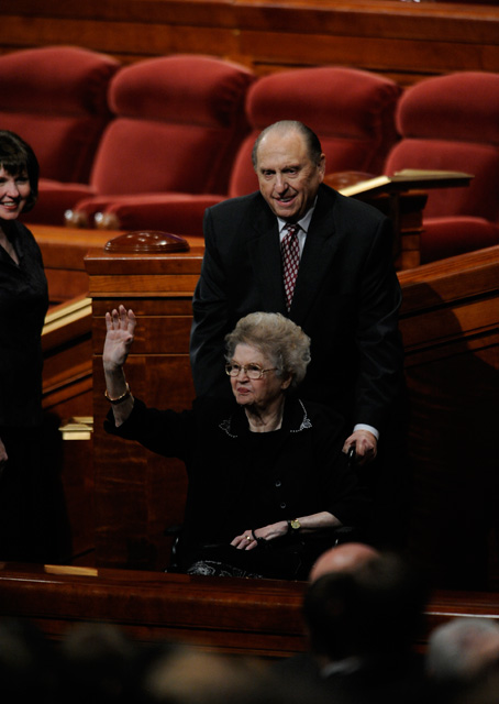 A photo of the prophet Thomas Monson pushing his wife in a wheelchair after General Conference.