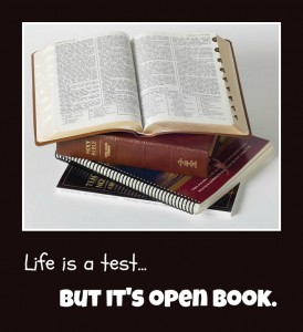"""Life is a test...but it's open book.""; a photo of Mormon study materials, including the scriptures, stacked up with the top set of scriptures opened up."