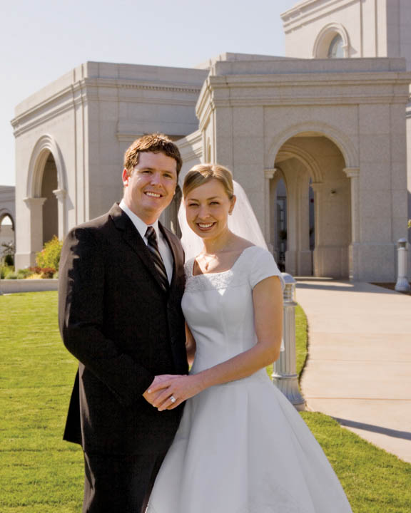 A photo of a Mormon couple outside of the temple after being married.