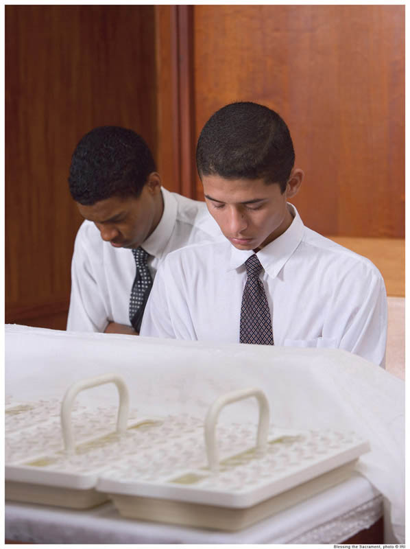 A photo of Aaronic Priesthood holders blessing the sacrament for a Mormon church service.