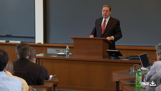 A photo of Elder Holland speaking at Harvard.
