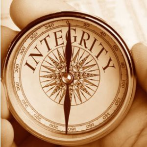 "Someone holding a compass with the word ""integrity"" on the dial."