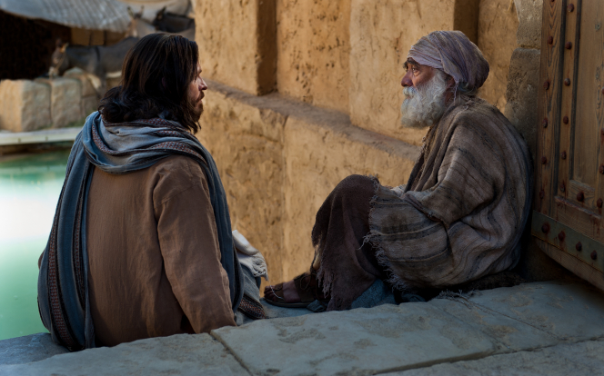 Jesus Christ visiting with a disabled man at the pool of Bethesda.