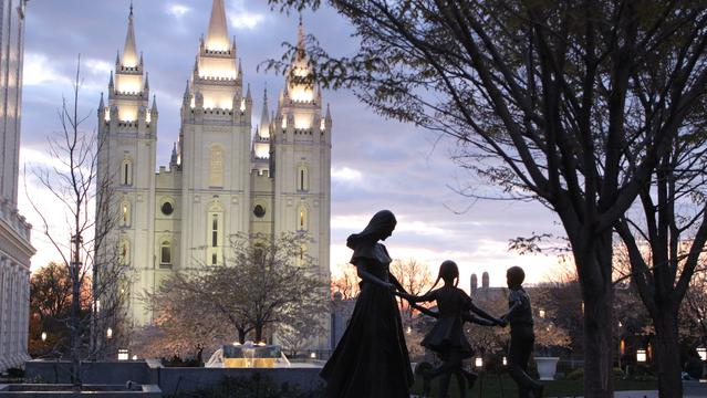 Statue of a family in front of the Salt Lake LDS Temple.