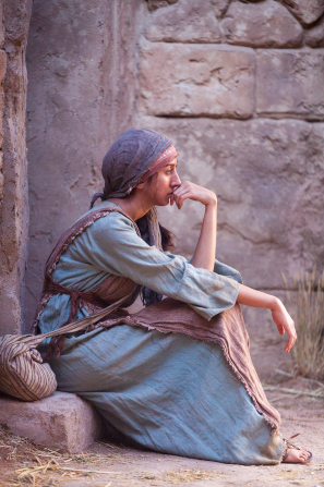 A woman sits and ponders the doctrines of the Savior