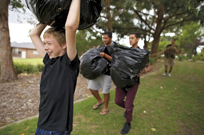 Mormon youth serve others by doing yard work.