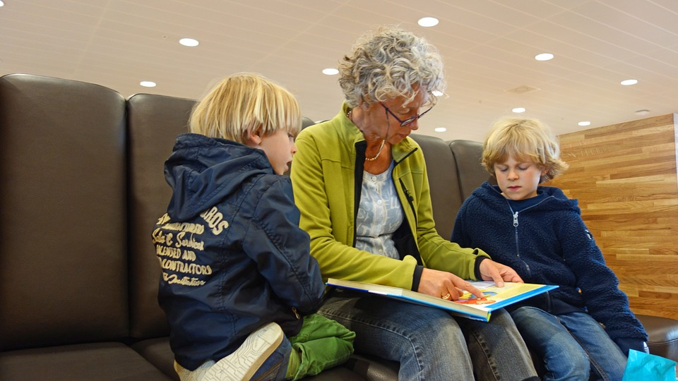 Grandmother reading with her grandchildren.