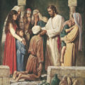 Jesus Christ healing a blind man.
