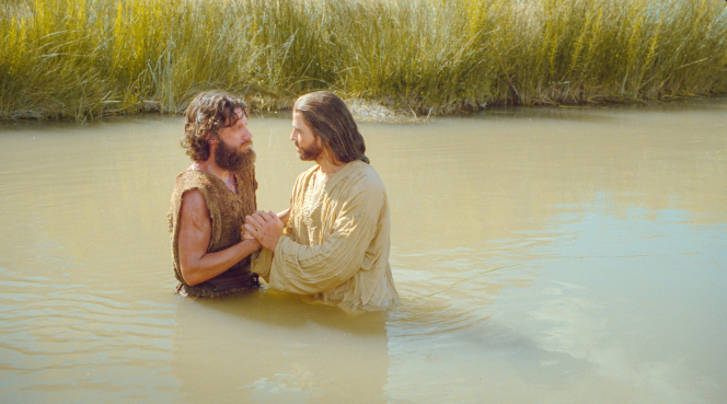 John the Baptist baptizing Jesus Christ.