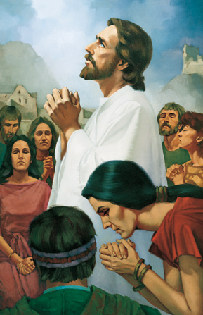 Jesus Christ praying with the Nephites.