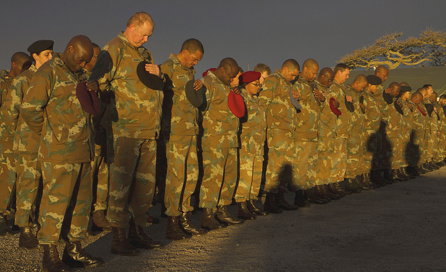 Soldiers take a moment to pray.