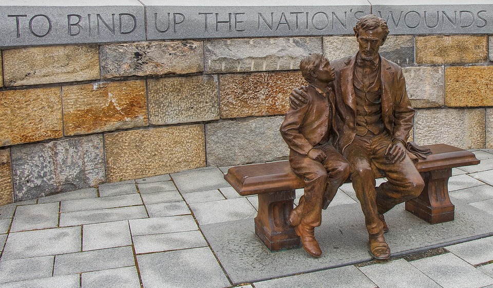 A statue of Abraham Lincoln reminds us to help bind up the wounds of those who sacrificed so much.