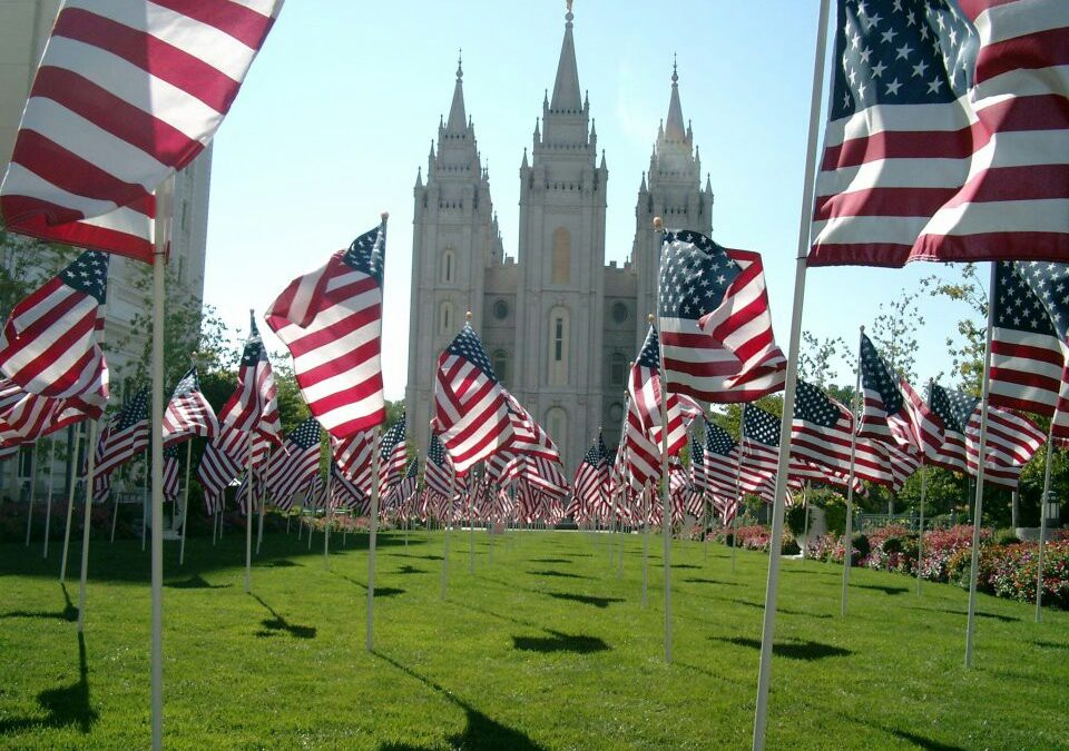 The Salt Lake City Temple is decorated with flags.
