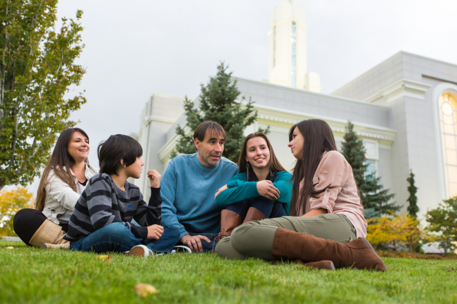 A family sitting together on the temple grounds.