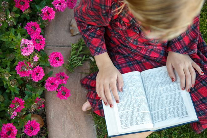 A girl studies the scriptures.