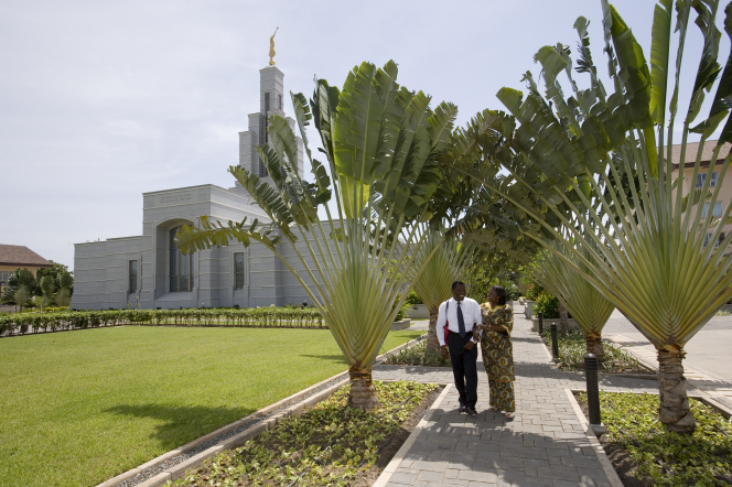 A couple walks outside the Accra Ghana Temple of The Church of Jesus Christ of Latter-day Saints.