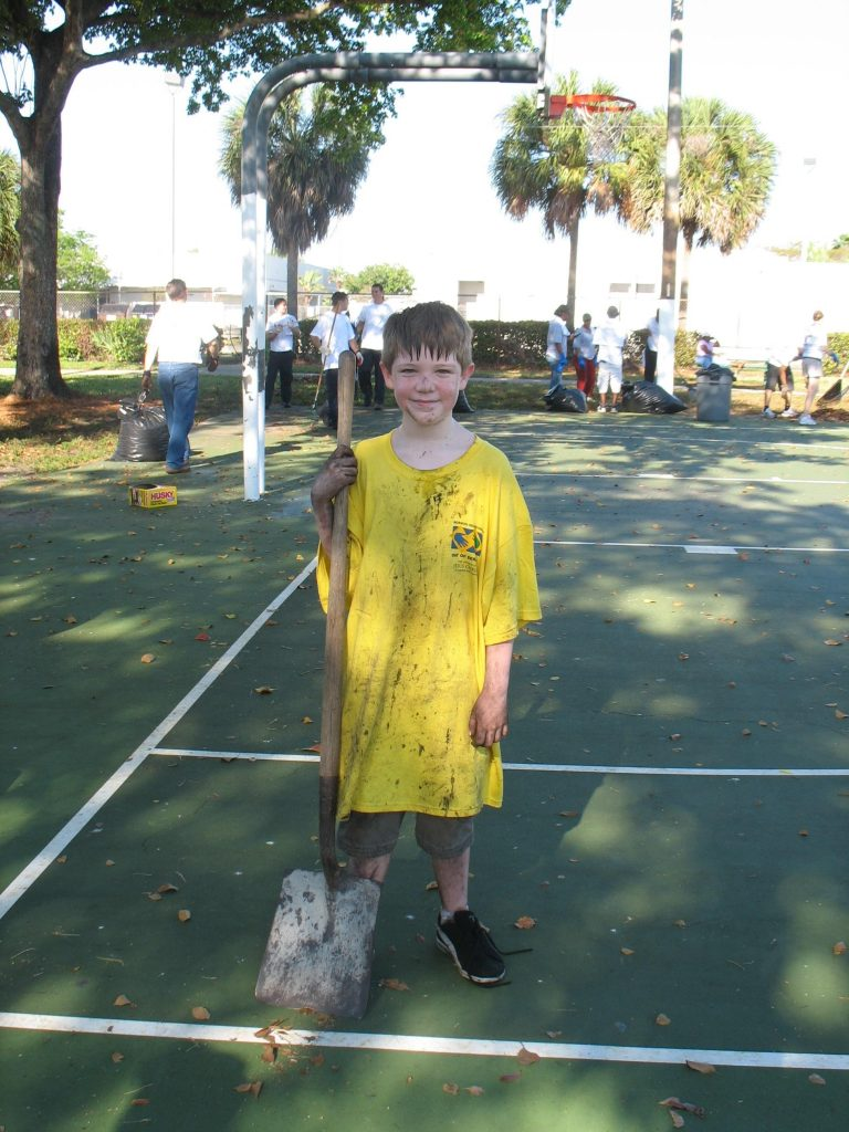 A boy is dirty after helping out during the Miramar Day of Service.