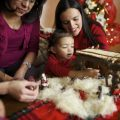A family sets up a Nativity set to celebrate Christmas.