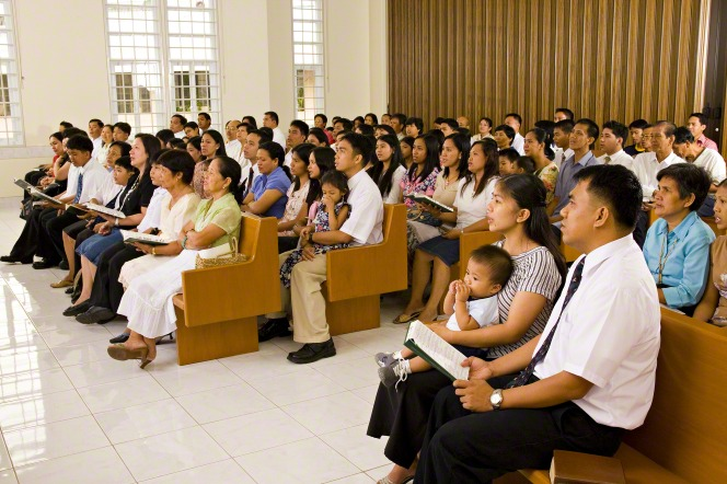 Members of The Church of Jesus Christ of Latter-day Saints participate in a sacrament meeting in the Phillipines.