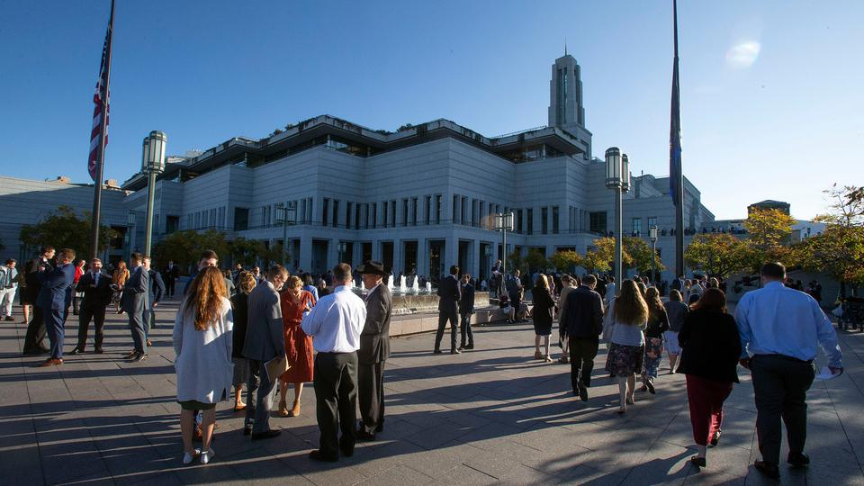 Members of The Church of Jesus Christ of Latter-day Saints, sometimes mistakenly called Mormons, gather outside the Conference Center in Salt Lake City.