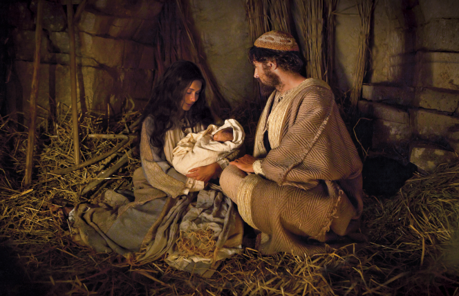 Mary, Joseph and the baby Jesus. Jesus Christ is the Light of the World.