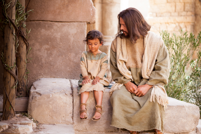 Jesus Christ sits with a young child. We celebrate the birth of the Savior at Christmas.