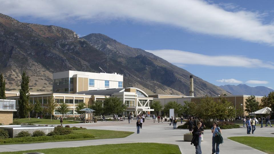 Students walk around the Quad in front of the BYU Wilkinson Center.