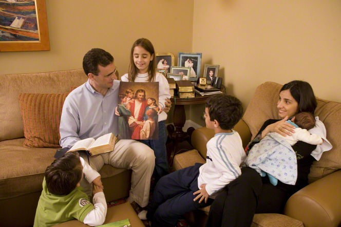 A family is studying about the Savior at home.