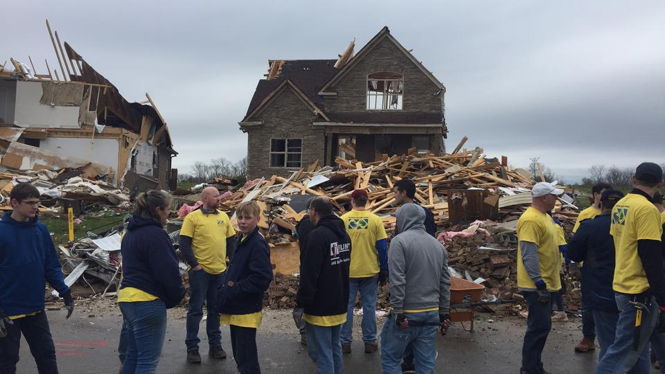 Members of The Church of Jesus Christ of Latter-day Saints help out after a tornado in Tennessee.