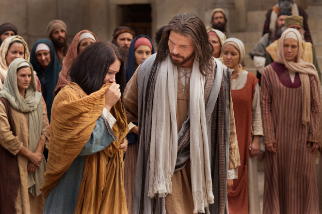The Savior walks with a woman taken in adultery. Overcoming the culture of grievances means loving others as the Savior did.