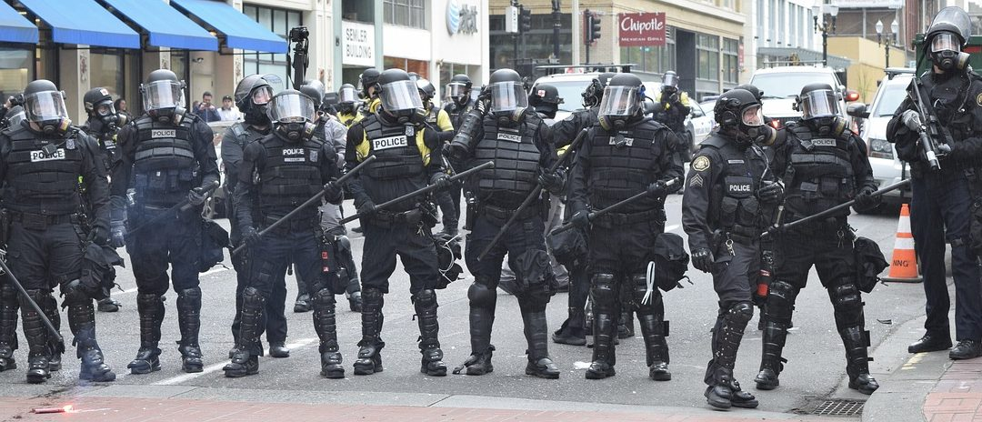 Police form a protective line during the rioting in Portland, Oregon.